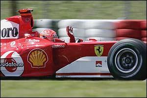 Michael Schumacher salutes his fans after claiming pole position