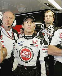Takuma Sato joins the rest of his BAR-Honda in the garage