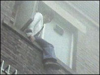 A member of staff being rescued from a window