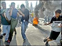 Palestinians carry a wounded youth in the Jabaliya refugee camp