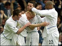 Alan Smith scores for Leeds and is mobbed by his team-mates