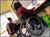A wheelchair user in an office