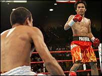 Manny Pacquiao puts down Juan Manuel Marquez.
