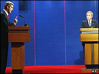 Democratic presidential candidate Sen. John Kerry, D-Mass., left ,speaks as President Bush listens during the presidential debate in Coral Gables, Thursday Sept. 30, 2004