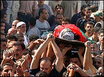 Palestinian mourners bury two militants