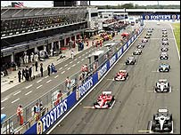 Formula One cars prepare for the start of the 2004 British Grand Prix