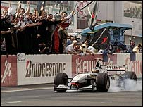 McLaren's Mika Hakkinen celebrates winning the 1998 Japan Grand Prix