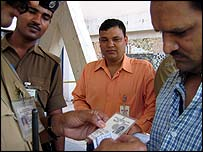 Checking a man's papers in Delhi