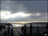 Dark skies across the Galata bridge in Istanbul, Turkey