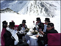 The novice climbers sit down to dinner