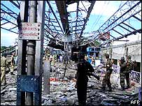 Soldiers survey damage at the train station