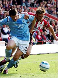 James Beattie battles with Joey Barton for the ball