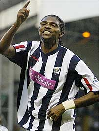 Kanu celebrates his opener for West Brom