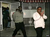 Haitian politicians Louis Gerald Gilles, right, and Roudy Heriveau in handcuffs