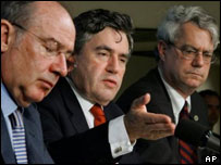 Gordon Brown takes questions at the IMF meeting, with IMF managing director Rodrigo Rato, left, and IMF spokesman Tom Dawson.