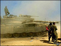 Israeli tank and soldiers inside Gaza Strip