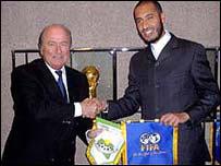 Al Saadi Gaddafi with Fifa boss Sepp Blatter (left)