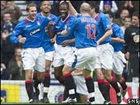 Marvin Andrews is congratulated by his Rangers team-mates