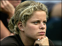 Kim Clijsters watches from the sidelines