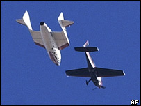 SpaceShipOne headed by a chase plane (AP)