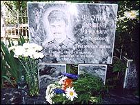 Symbolic grave stone for son Dmitry Chikunov (picture Amnesty International)