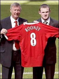 Sir Alex Ferguson (left) unveils Wayne Rooney as a Manchester United player