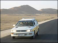 A car on the Kabul to Kandahar highway through southern Afghanistan