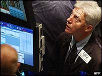 Traders watch prices on computer monitors on the floor of the New York Stock Exchange just after the opening bell, 11 May, 2004.