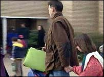 Father taking daughter to school