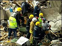 Rescuers carry a victim from the scene