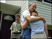 Michael Berg hugs daughter Sara as son David stands nearby at their house in Chester, Pennsylvania