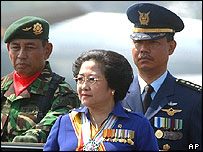 Indonesian President Megawati Sukarnoputri inspects her troops for the last time as president during the 59th Anniversary of the Indonesian Military, Tuesday, Oct. 5, 2004, at Halim Air Force Base