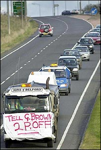 A fuel protester holds up traffic outside Berwick-on-Tweed in November 2000