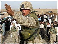 US soldier directs crowd in Iraq