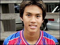 Teerathep Vinothai, 16, a Thai teenage soccer star, poses for photograph in this photo taken in September 2001.