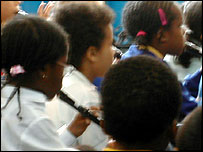 Pupils playing recorders