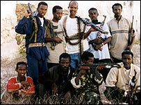 Muktar (bottom row, second from right) with fellow gun-for-hire militia