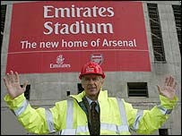 Arsenal boss Arsene Wenger outside the club's new ground. Credit: Emirates/Lawrence Lustig