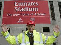 Arsenal boss Arsene Wenger outside the club's new ground. Credit: Emirates/Lawrence Lustig