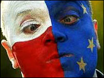 Man's face painted with EU and Polish flags