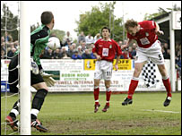 Brian Carey rises at the far post to give Wrexham the lead (SportPix)