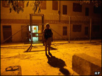 A US military police officer guards the high-security block of the Abu Ghraib prison (Pic: AP/John Moore)