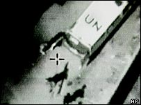 Video still of an object being loaded onto a UN ambulance