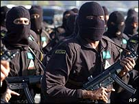 Saudi special forces in masks march in line