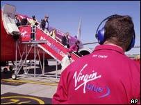 Virgin Blue worker and plane on runway