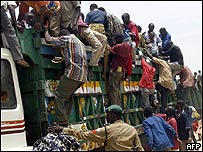 Christians arrive aboard trucks after fleeing the violence