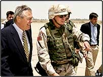 US Defence Secretary Donald H Rumsfeld walking next to Lt Gen Ricardo Sanchez after arriving in Baghdad