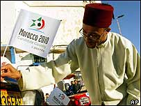 Ismail Bakkar, adjusts a flag in support of Morocco's bid to host the 2010 soccer World Cup