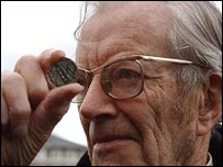 Maurice Wilkins examines a DNA 50 commemorative coin (PA)