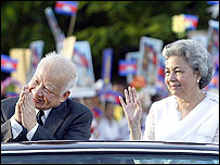 King Norodom Sihanouk and Queen Monineath greet from a limousine after a ceremony celebrating Cambodia's fifty years of Independence in Phnom Penh , 2003